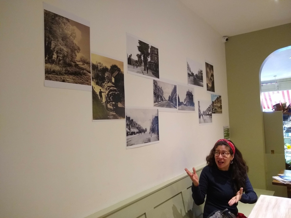 Elizabeth Salazar Guerra in Helen's Coffee on the Green beside the display by Chingford Historical Society