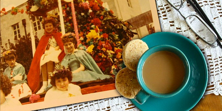 Shows an old photo and a cup of tea